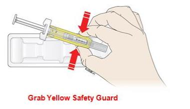 Open the package and remove the syringe from the tray. Grab the yellow safety guard to remove the prefilled syringe from the tray.